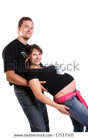 happy pregnant woman and her husband having fun isolated against white background - stock photo