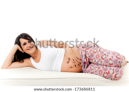 Happy Pregnant woman in the coach - stock photo