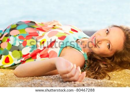 Happy pregnant woman on the beach - stock photo