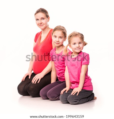 Happy pregnant woman with her kids exercising isolated on white background - stock photo
