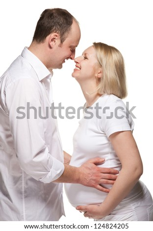 Happy pregnant woman with husband; isolated on white - stock photo