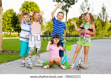 Happy preschool children in a city park - stock photo