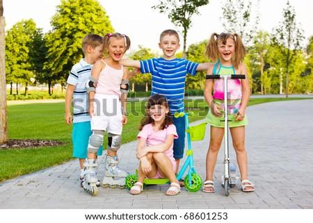 Happy preschool team in a city park - stock photo