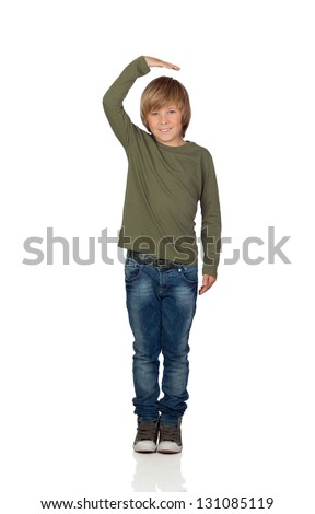 Happy preteen boy pointing measuring what has grown isolated on white background - stock photo