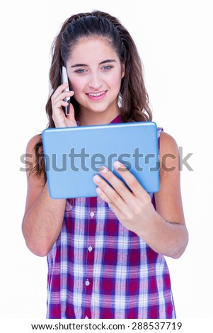 Happy pretty brunette using tablet computer and having phone call on white background