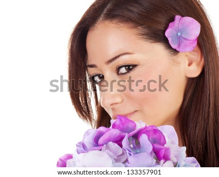 Happy pretty female relaxed in spa salon, closeup portrait of cute seductive girl with fresh purple orchid flowers isolated on white background, beauty concept - stock photo