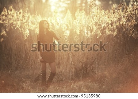 Happy pretty girl in field at sunset .Art photo - stock photo