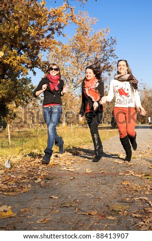 Happy pretty girls in the park - stock photo