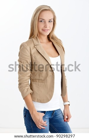Happy pretty teenage girl smiling at camera, posing in studio, cutout on white.?