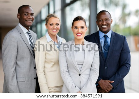happy professional business team looking at the camera