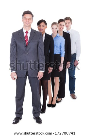 Happy Professional Man And Woman Standing In A Row Over White Background