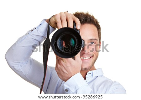 Happy professional photographer with digital DSLR camera - stock photo
