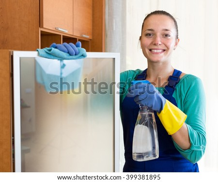 happy professional russian  cleaner  cleaning the office - stock photo
