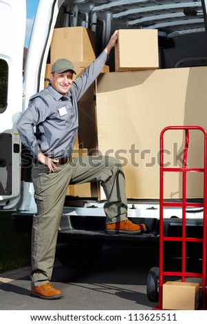 Happy professional shipping courier. Delivery postal service. - stock photo