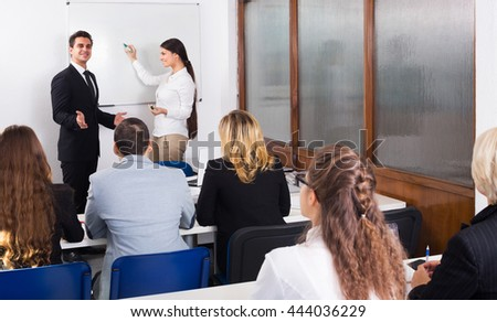 Happy professor and professionals at extension business courses indoors - stock photo