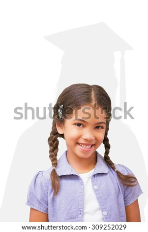 Happy pupil against silhouette of graduate - stock photo