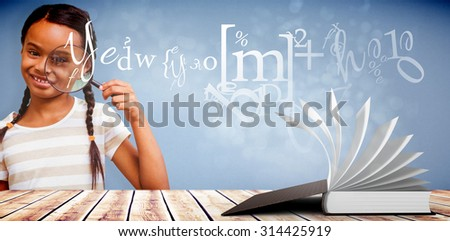 Happy pupil with magnifying glass against light design shimmering on silver - stock photo