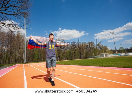 Happy race winner waving Russian flag on the track