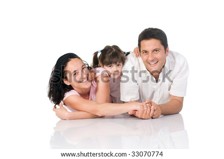 Happy real smiling family lying down isolated on white background - stock photo