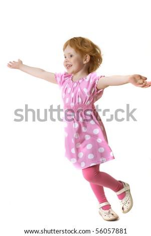 Happy red hair little girl running - stock photo