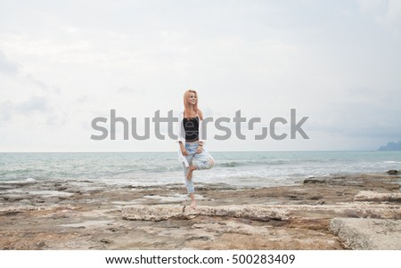 happy red hair young woman dreams to fly on winds on seaside