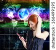 Happy red-haired girl with a mobile phone.Globalization Internet Connect technologies - stock photo