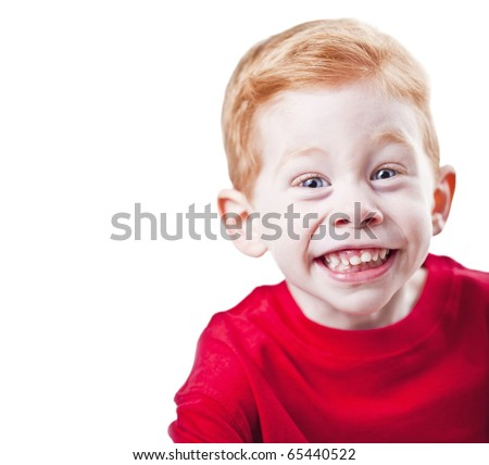Happy redheaded boy smiling facing forwards on white background