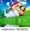Happy relationship outdoor beside a river - stock photo