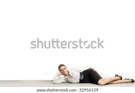 Happy relaxed businesswoman under empty white board , lots of copyspace - stock photo