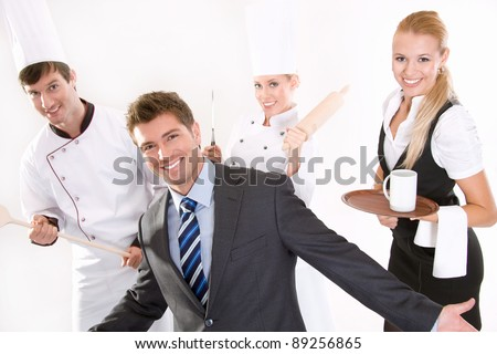 Happy restaurant staff - stock photo