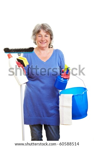Happy retired woman holding many cleaning supplies - stock photo