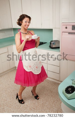 Happy retro styled woman drinks coffee while on her toes - stock photo