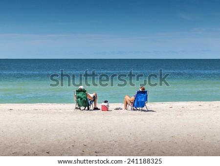 Happy Romantic Couple Enjoying Beautiful view at the Beach - stock photo