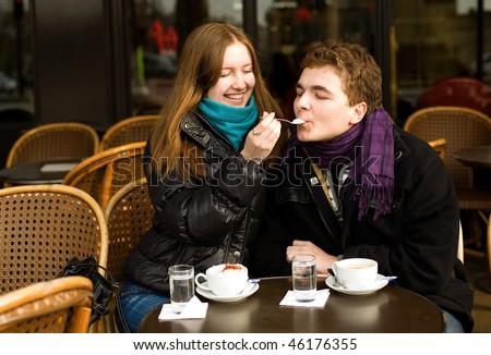 Happy romantic couple in a Parisian street cafe - stock photo