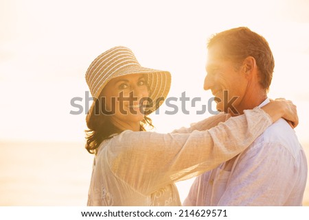 Happy Romantic Mature Couple in Love on the Beach at Sunset  - stock photo