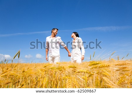 Happy running barefoot couple of two  smiling walk - stock photo