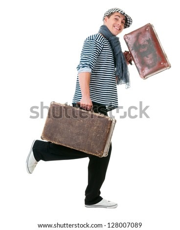 Happy running young male traveller with two old vintage suitcases isolated on white background - stock photo