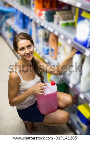 happy russian people buying detergents for house in the shopping mall