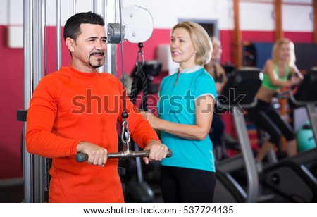 happy russian   people  weightlifting training in modern health club