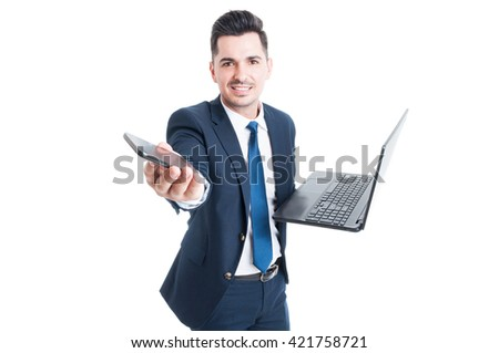 Happy salesman holding laptop and smartphone as multitasking and modern technology concept isolated on white - stock photo