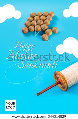 Happy Sankranti, Sankranti greeting card, indian festival with tilgul laddu or laddoo as kite on blue background depicting sky, Makar Sankranti festival in hindu religion in India, indian sweet laddu - stock photo