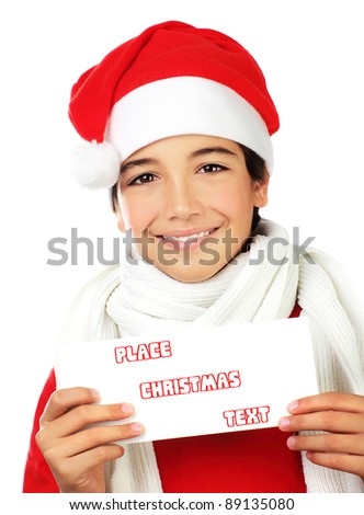 Happy Santa boy smiling, portrait of a cute teen holding blank card isolated on white background, kid wearing red Christmas hat, winter holidays celebration - stock photo
