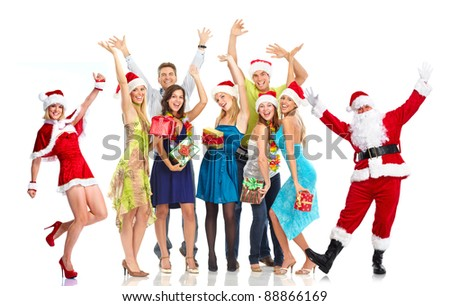 Happy Santa Claus and group of people. Christmas party. - stock photo
