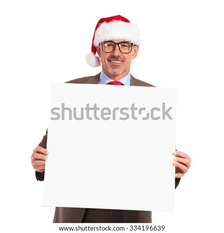 happy santa claus businessman holding a blank board on white background