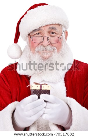 Happy Santa Claus holds Christmas gift in hands, isolated on white background - stock photo