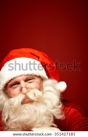 Happy Santa Claus looking at camera with smile - stock photo