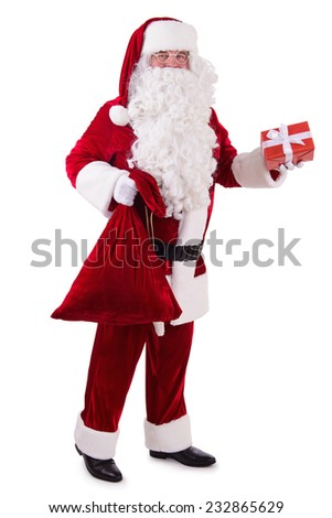 happy Santa Claus with giftboxes and big bag. Isolated on white background - stock photo