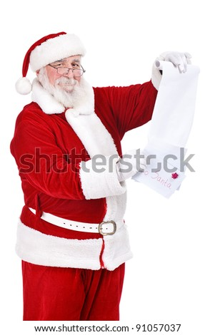 happy Santa Claus with letters and list reading wishes  of children, isolated on white background - stock photo