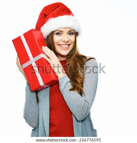Happy Santa Girl holding gift box. Christmas portrait of young woman isolated on white background. - stock photo