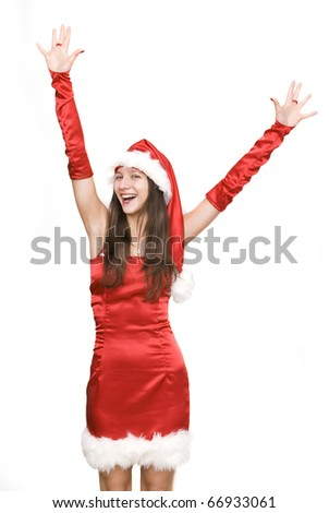 Happy santa girl, with hands up in the air. Isolated on white